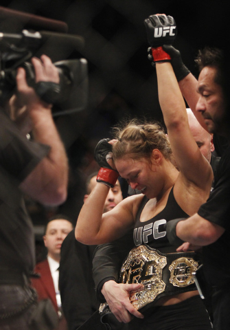 Ronda Rousey defeats Miesha Tate during UFC 168 at the MGM Grand Garden Arena in Las Vegas on Friday, Dec. 28, 2013. (Jason Bean/Las Vegas Review-Journal)