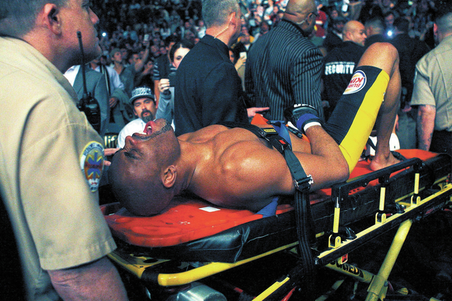 Anderson Silva gets carted out of the arena after getting his leg broken by Chris Weidman during UFC 168 at the MGM Grand Garden Arena in Las Vegas on Friday, Dec. 28, 2013. (Jason Bean/Las Vegas  ...