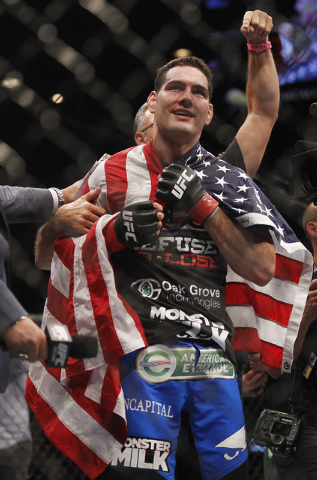 Chris Weidman celebrates following his victory over Anderson Silva during UFC 168 at the MGM Grand Garden Arena in Las Vegas on Friday, Dec. 28, 2013. (Jason Bean/Las Vegas Review-Journal)