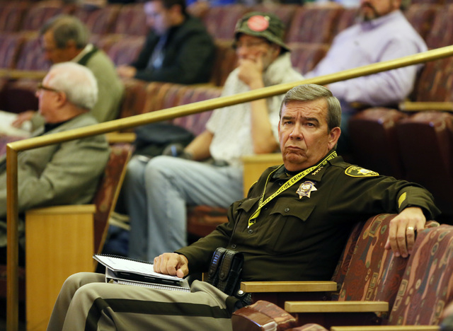 Clark County Sheriff Doug Gillespie listens to a speaker address Clark County Board of Commissioners about More Cops, which is a potential sales tax increase designed for the purpose of employing  ...