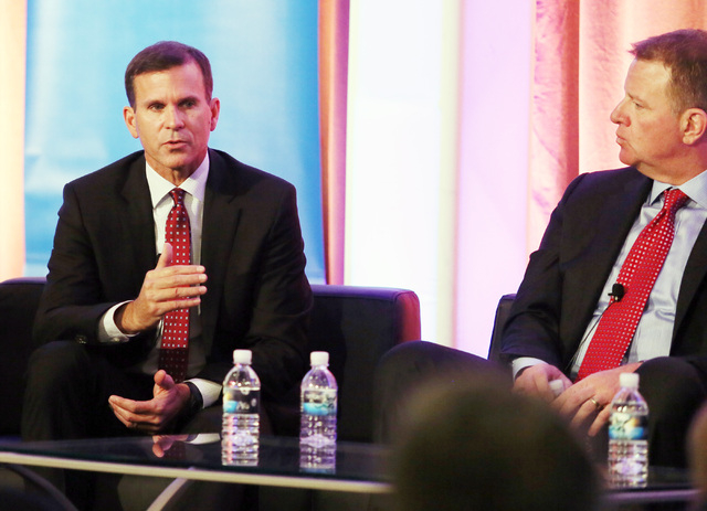 Gary Darcy, left, senior vice president of marketing at National Hot Rod Association, speaks during a panel discussion at the Motorsport Marketing Forum at Aria hotel-casino Wednesday, Dec. 4, 201 ...
