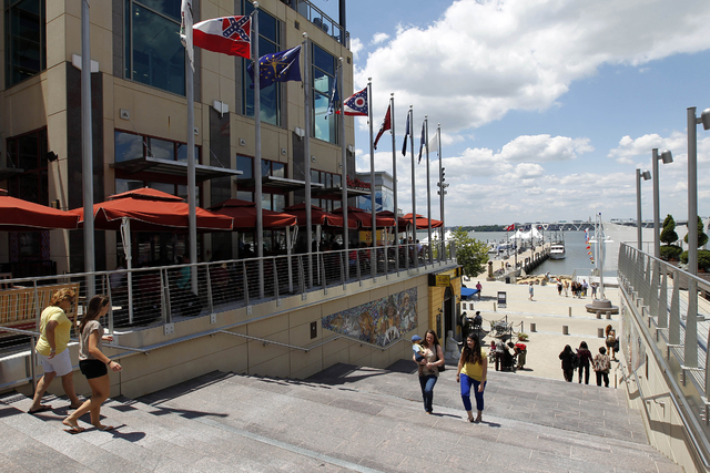 People walk around the National Harbor Friday, June 15, 2012 in Oxon Hill, Md. (AP Photo/Alex Brandon)