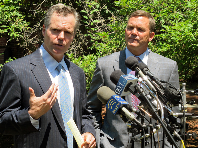 James Murren, chairman and CEO of MGM Resorts International, left, and Jon Peterson, senior vice president of Peterson Companies, talk to reporters during Murren's visit in Annapolis, Md., on Frid ...