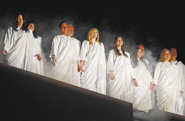 Volunteers perform as angels in a live nativity performance at the Opportunity Village on South Buffalo Drive in Las Vegas Tuesday, Dec. 10, 2013. The 25 minute performance is free and runs from D ...