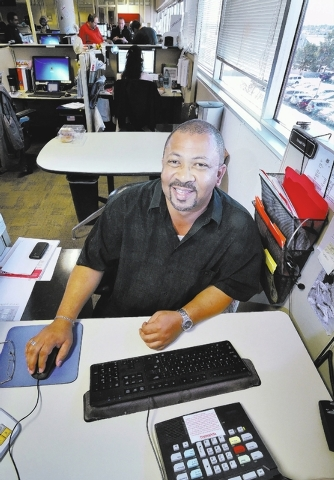 Donald Kidd, a retail customer service representative at NV Energy, poses at his desk in the company's call center at 6226 W. Sahara Ave. in Las Vegas on Wednesday, Nov. 27, 2013. (Bill Hughes/Las ...