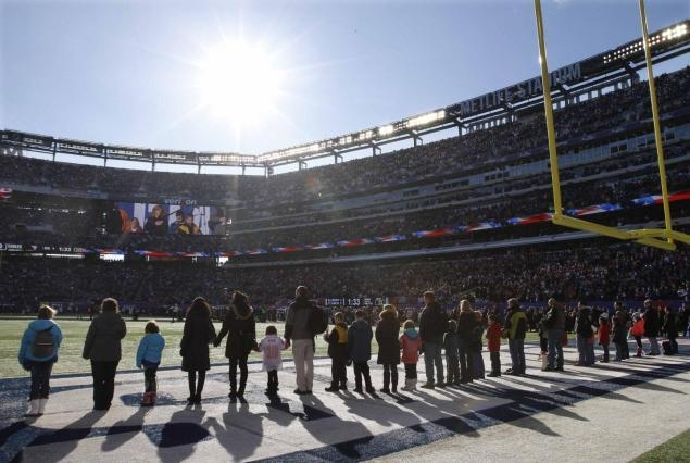 Students and families from Sandy Hook Elementary School attend a Giants-Eagles game at MetLife Stadium days after the tragic school shooting. (Gary Hershorn/Reuters)