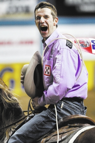Shane Hanchey celebrates after competing in the tie-down roping event on the final night of the National Finals Rodeo in Las Vegas Saturday, Dec. 14, 2013.  (John Locher/Las Vegas Review-Journal)