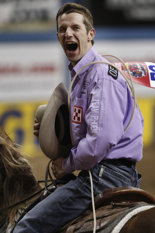 Shane Hanchey celebrates after competing in the tie-down roping event on the final night of the National Finals Rodeo in Las Vegas Saturday, Dec. 14, 2013. Hanchey is first in the total world earn ...