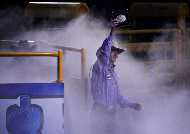 Shane Hanchey celebrates after winning the world championship in tie-down roping on the final night of the National Finals Rodeo on Saturday. On Sunday, the board of the Colorado Springs, Colo.-ba ...
