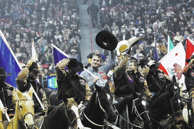 Contestants salute the crowd before the start of the National Finals Rodeo at the Thomas & Mack Center earlier this month. The NFR may move to Florida in 2015.(Jason Bean/Las Vegas Review-Journal)