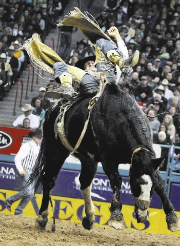 Bobby Mote competes in the bareback riding event during the 9th performance at the National Finals Rodeo at the Thomas & Mack Center in Las Vegas Friday, Dec. 14, 2012. (John Locher/Las Vegas Revi ...