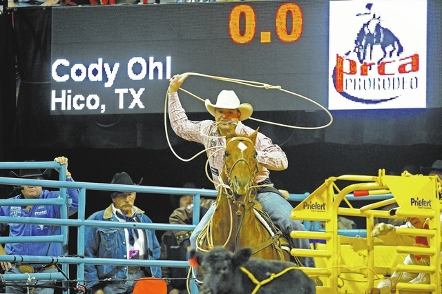 Tie-down roper Cody Ohl of Hico, Texas, ties up a calf to a sixth place time of 8.80 seconds during the tie-down roping competition in the fourth round of the 54th Wrangler National Finals Rodeo a ...