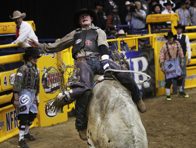 Bull rider Steve Woolsey posts a score of 86.5 during Day 1 of the Wrangler National Finals Rodeo at the Thomas and Mack Center in Las Vegas on Dec. 5, 2013. (Jason Bean/Las Vegas Review-Journal)