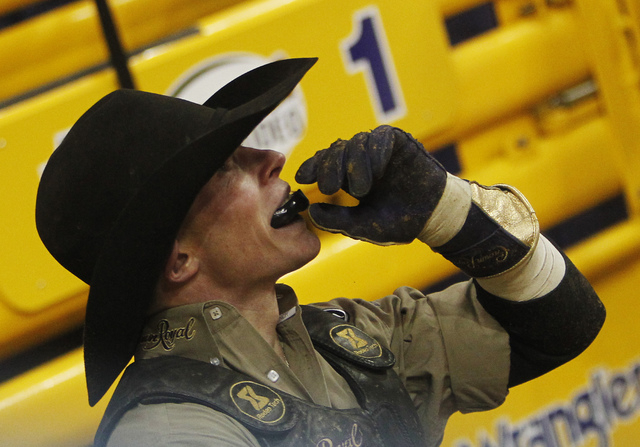 Bull rider Steve Woolsey looks up to see that he scored a 86.5 during Day 1 of the Wrangler National Finals Rodeo at the Thomas and Mack Center in Las Vegas on Dec. 5, 2013. (Jason Bean/Las Vegas  ...