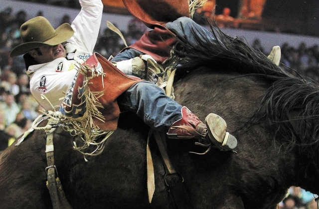 Kaycee Feild competes during the Bareback Riding event on day 7 of the Wrangler National Finals Rodeo at the Thomas and Mack Center in Las Vegas on Dec. 11, 2013. (Jason Bean/Las Vegas Review-Journal)