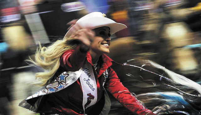 Miss Rodeo America 2013 Chenae Shiner enters the arena during day 1 of the Wrangler National Finals Rodeo at the Thomas and Mack Center in Las Vegas on Dec. 5, 2013. (Jason Bean/Las Vegas Review-J ...