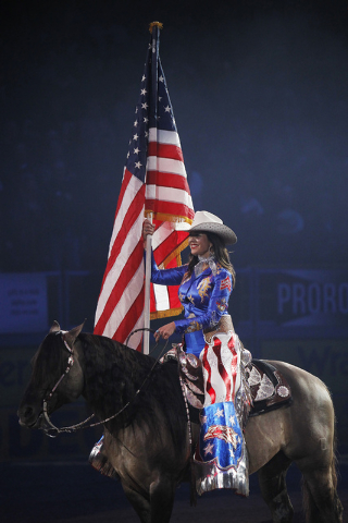 The American flag is honored during day 1 of the Wrangler National Finals Rodeo at the Thomas and Mack Center in Las Vegas on Dec. 5, 2013. (Jason Bean/Las Vegas Review-Journal)