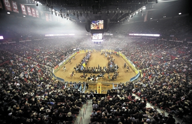 Contestants at the National Finals Rodeo take part in the opening ceremony on the first night of the event at the Thomas & Mack Center in Las Vegas Thursday, Dec. 5, 2013. (John Locher/Las Vegas R ...