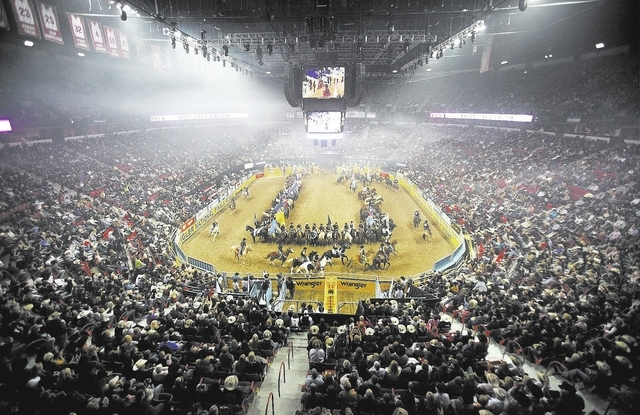 Contestants at the National Finals Rodeo take part in the opening ceremony Thursday at the Thomas & Mack Center. The group that stages the event will inform Las Vegas within 30 days whether a 10-y ...