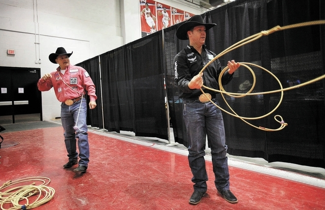 Trevor Brazile, right, and Cody Ohl try out their ropes on the first night of the National Finals Rodeo at the Thomas & Mack Center in Las Vegas Thursday, Dec. 5, 2013. (John Locher/Las Vegas Revi ...