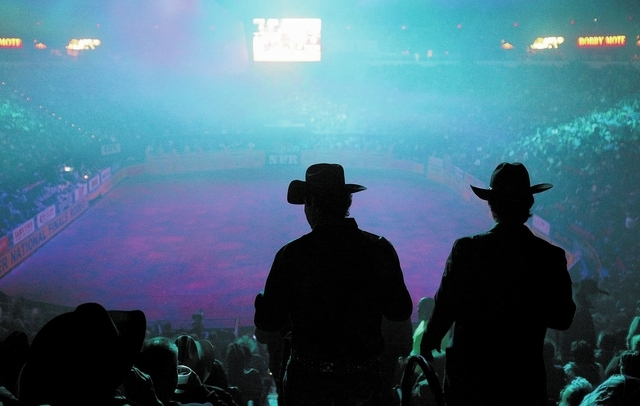 Fans take their seats before the start of the first night of the National Finals Rodeo at the Thomas & Mack Center in Las Vegas Thursday, Dec. 5, 2013. (John Locher/Las Vegas Review-Journal)