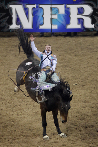 J.R. Vezain of Cowley, Wyoming competes in the bareback riding event on the second night of the National Finals Rodeo at the Thomas & Mack Center in Las Vegas Friday, Dec. 6, 2013. (John Locher/La ...