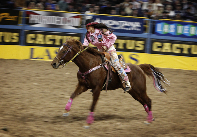 Fallon Taylor of Whitesboro, Texas competes in the barrel racing event on the second night of the National Finals Rodeo at the Thomas & Mack Center in Las Vegas Friday, Dec. 6, 2013. (John Locher/ ...