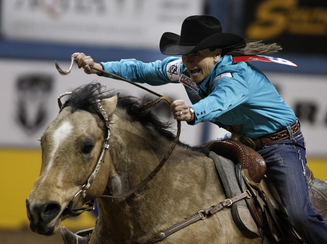 Lisa Lockhart competes in the barrel racing event on the third night of the National Finals Rodeo at the Thomas & Mack Center in Las Vegas Saturday, Dec. 7, 2013. (John Locher/Las Vegas Review-Jou ...