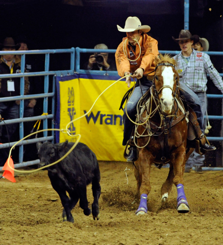 Shane Hanchey ropes his calf in the tie-down competition during the fourth round at the 55th Wranglers National Finals Rodeo at the Thomas & Mack Center on Sunday. (David Becker/Las Vegas Review-J ...