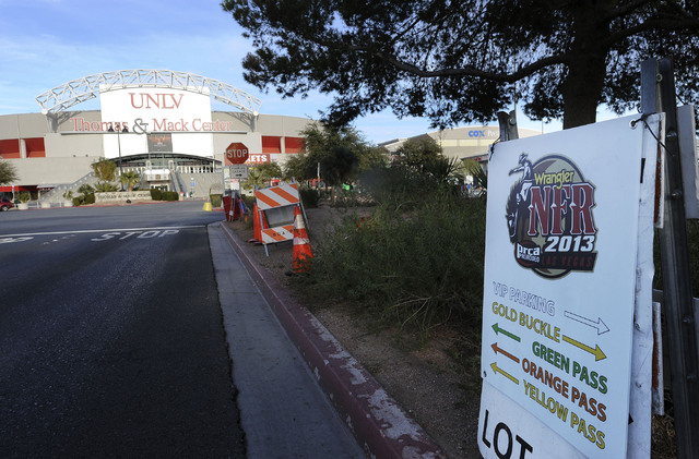 A leftover sign pointing to parking for the National Finals Rodeo is seen at the Thomas and Mack Arena on the UNLV campus.  (Jerry Henkel/Las Vegas Review-Journal)