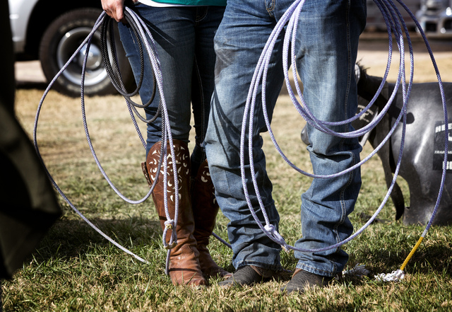 National Finals Rodeo team roper contestant Charly Crawford, right, and his fiance, Jackie Hobbs, pose at the National Finals Rodeo livestock corrals near the Thomas & Mack Center at UNLV on Tuesd ...