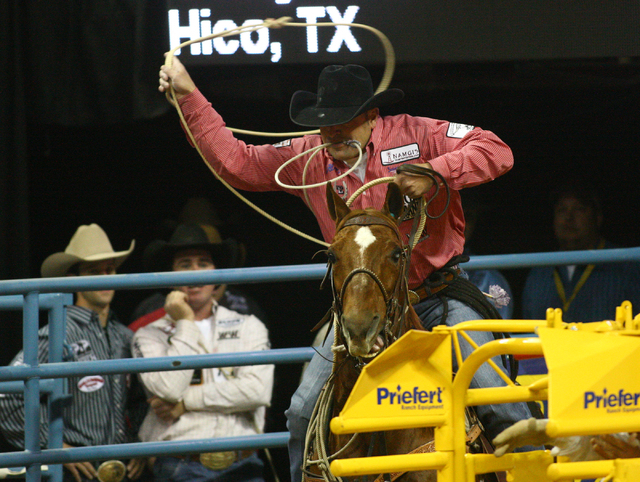 Cody Ohl rides during a disastrous run in the ninth round of tie-down roping Friday. He received a 10-second penalty and saw his chances of winning the world title all but end. (Chase Stevens/Las  ...