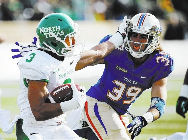 North Texas Brelan Chancellor (3) is taken down by Tulsa's Marcus Pate (39) on Nov. 30. Chancellor and the Mean Green will play UNLV in the Heart of Dallas Bowl on Jan. 1. (AP Photo/Tulsa World, T ...