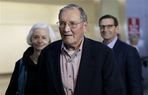 Merrill Newman, center, walks beside his wife Lee, left, and his son Jeffrey after arriving at San Francisco International Airport on Saturday, Dec. 7, 2013. Newman was detained in North Korea lat ...