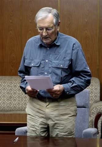 In this Nov. 9, 2013 photo released by the Korean Central News Agency (KCNA) and distributed Nov. 30, 2013 by the Korea News Service, U.S. citizen Merrill Newman, 85, reads a document, which North ...