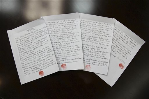 In this Nov. 9, 2013 photo released by the Korean Central News Agency (KCNA) and distributed Nov. 30, 2013 by the Korea News Service,  hand written statements with red thumb prints, which North Ko ...