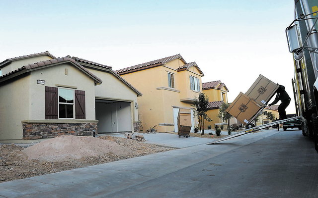 Movers unload new cabinets for homes still under construction in the Sedona neighborhood located near W. Tropicana Avenue and Hualapai Way on Thursday, Dec. 26, 2013. (David Becker/Las Vegas Revie ...