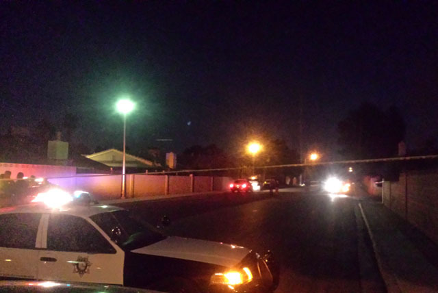 Las Vegas police investigate an officer-involved shooting near Harmon Avenue and Pecos Road on Monday night. (Colton Lochhead/Las Vegas Review-Journal)