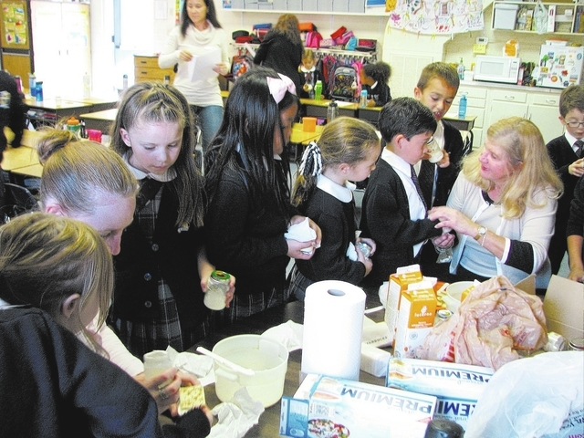 Rebecca Daley's first-grade class at Our Lady of Las Vegas School, 3046 Alta Drive, makes butter in baby food jars, Nov. 20, as part of a science project. (F. Andrew Taylor/View)