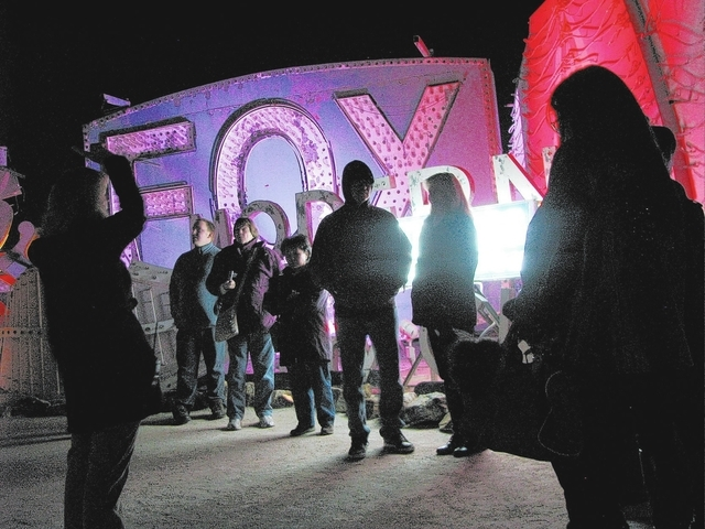 A group takes a night tour at the Neon Museum, 770 Las Vegas Blvd. North. (F. Andrew Taylor/View)