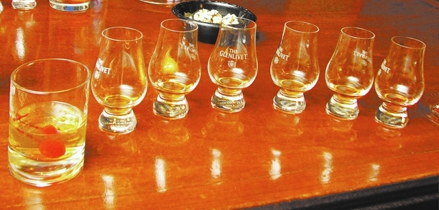 Guests sampled eight of the 1,000 types of whiskey at the Whiskey Attic during a Nov. 10 tasting. (F. Andrew Taylor/View)