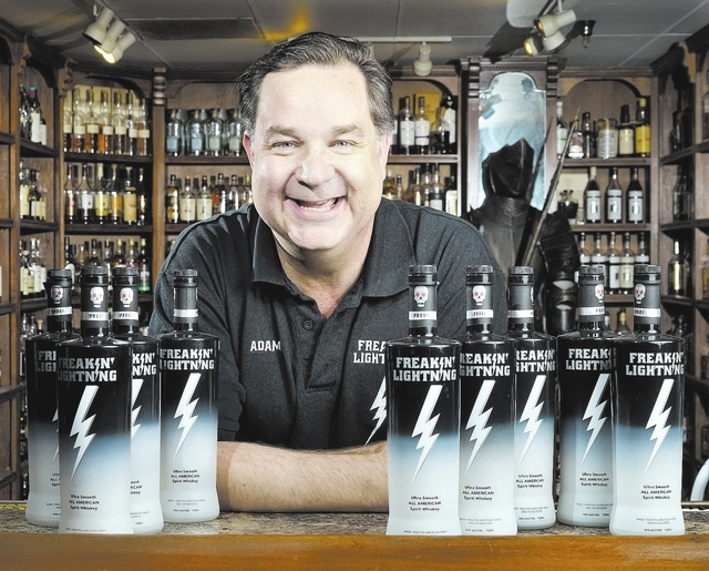 Adam Carmer, owner of the Whiskey Attic, 4700 S. Maryland Parkway, created Freakin' Lightning whiskey with his brother Mark. Adam Carmer also owns the Freakin' Frog, which is downstairs from t ...