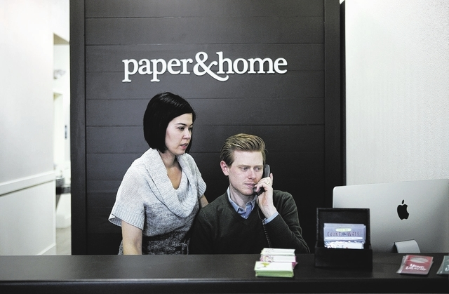 Paper & Home owners Brooke and Michael Coxen work at the front desk of their store, Nov. 19. The couple recently opened their first brick-and-mortar location at 4555 S. Fort Apache Road, Suite 138 ...