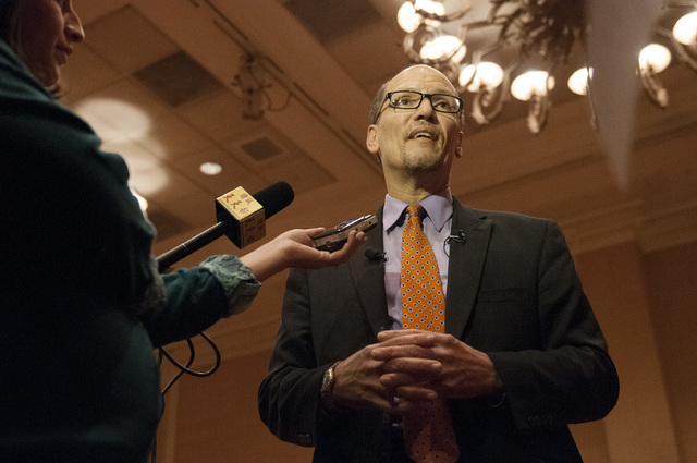 U.S. Secretary of Labor Thomas E. Perez speaks to reporters following his speech about the economic benefits of providing a path to earned citizenship to undocumented immigrants currently living i ...