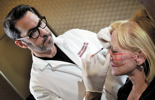 Dr. Terry Higgins injects Debbie Hale with Botox at Anson and Higgins Plastic Surgery Associates at 8530 W. Sunset Road in Las Vegas on Dec. 20. (Bill Hughes/Las Vegas Review-Journal)