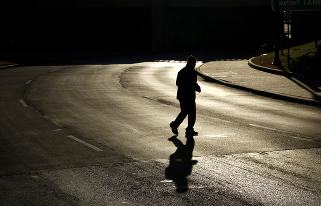 A man takes a photograph of an X on the road in Dealey Plaza in Dallas Tuesday, Dec. 31, 2013. The X marks a spot where President John F. Kennedy was shot. (John Locher/Las Vegas Review-Journal)