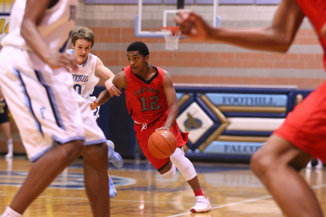 Las Vegas' Devon Colley (12) drives past Foothill's Vincent Mondugno (10) during a game at Foothill High School in Henderson on Tuesday, Dec. 10, 2013. (Chase Stevens/Las Vegas Review-Journal)
