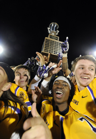 Team Sunrise players celebrate their 27-23 win over Team Sunset during the 42nd annual Lions Charity all-Star game at Fertitta Field in Las Vegas Saturday, December 14, 2013.(Josh Holmberg/Las Veg ...