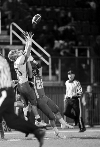Team Sunrise wide receiver Gio Hernandez, left, of Green Valley High School intercepts Team Sunset's hail marry pass attempt intended for Calvin Beaulieu of Palo Verde High School as time expires  ...
