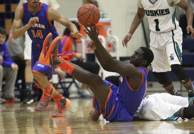 Gorman's Obim Okeke (11) grabs a loose ball against Sheldon during their game in the Tarkanian Classic at Bishop Gorman High School in Las Vegas, Thursday, Dec. 19, 2013. (Jerry Henkel/Las Vegas R ...